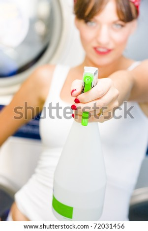 House Cleaning Holdup See A Woman Holding A Bottle Of Household Cleaner Liquid Taking Aim With The Spray Bottle In A Sharp Shooter Action Concept - stock photo