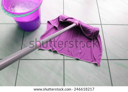 House cleaning with a mop and bucket. - stock photo