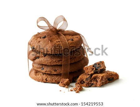 house cookies with slices of chocolate are tied up by a tape - stock photo