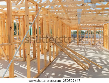 house currently under construction against blue sky - stock photo