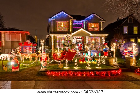 House decorated and lighted for Christmas and for New Year Eve . Night in Vancouver, Canada. - stock photo