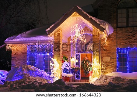 House decorated with Christmas lights - stock photo