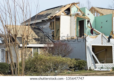 house destroyed by a tornado during spring. Natural disaster.  - stock photo