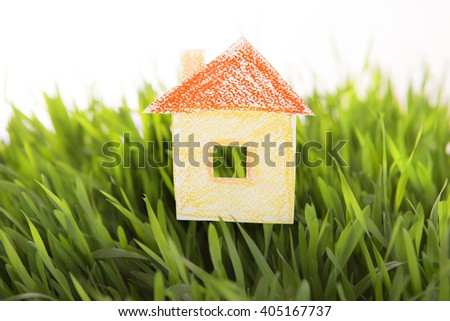 House drawn icon on Grass green background. Real Estate in ecological area. Social concept. The property. Lending for ecohouse construction. Green Buildings, Nanotechnology in Construction  - stock photo
