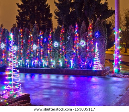 House driveway decorated and lighted for Christmas and for New Year Eve . Night in Vancouver, Canada. - stock photo