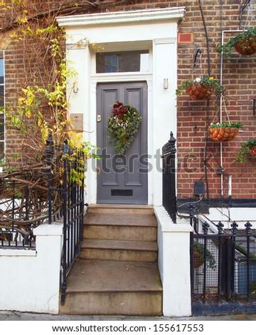 house entrance, Christmas decorated  - stock photo