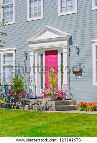 House entrance with colorful door. Landscape design. - stock photo