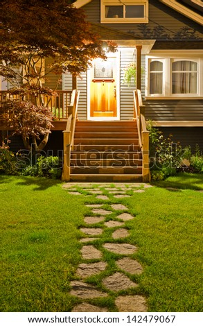 House entrance with nicely paved long doorway  at night, dawn time. - stock photo