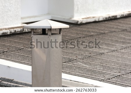 House exhaust stack - stock photo