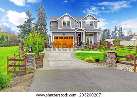 House exterior. Big house with column porch, garage and driveway view - stock photo