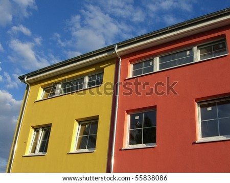 House facade on the blue sky - stock photo