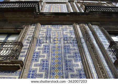 House facade with white and blue tiles in Mexico city - azulejos - stock photo