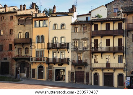 house facades in the medieval Piazza Grande square , Arezzo, Italy - stock photo