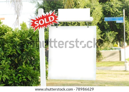 house for sale and sold sign - stock photo