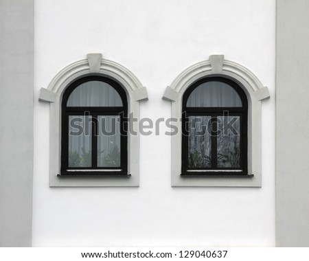 house front with two arched windows, retro style - stock photo