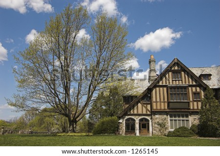 House, grass, blue sky - stock photo