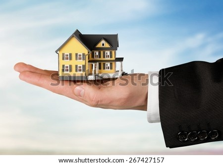 House, Human Hand, Residential Structure. - stock photo