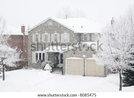 House in a heavy snowfall - stock photo
