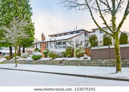 House in cold,chilly and frosty winter time covered with snow . Vancouver, Canada. - stock photo