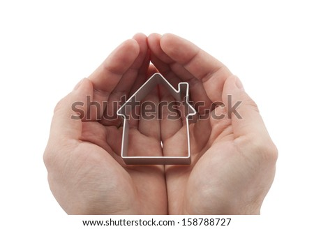 House in hands isolated on white - stock photo