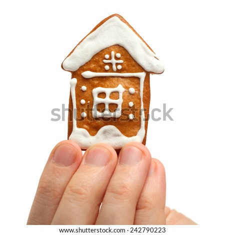 House in male hand isolated real estate concept - stock photo