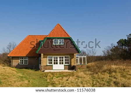 House in the dunes - stock photo