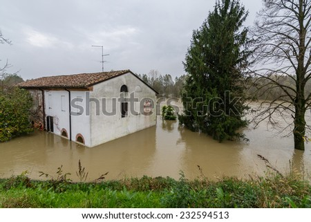 House in the flood river - stock photo
