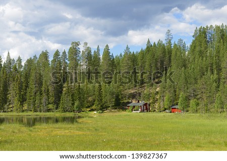House in the swamp. Finland, Lapland - stock photo