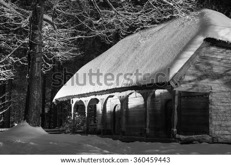 House in the winter night - stock photo