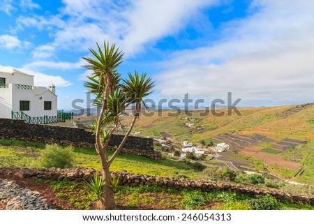 House in tropical landscape of Lanzarote island at Mirador de Los Valles, Spain - stock photo
