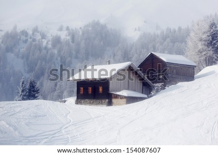 house in winter forest - stock photo