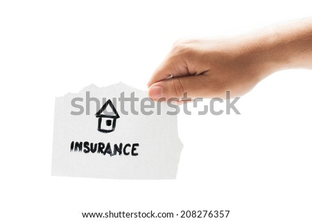 House insurance concept using a hand holding a piece of paper on white background - stock photo