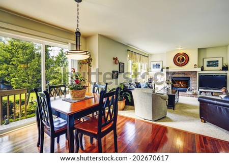 House interior. Open floor plan. View of living room with dining table set and open door to walkout deck - stock photo