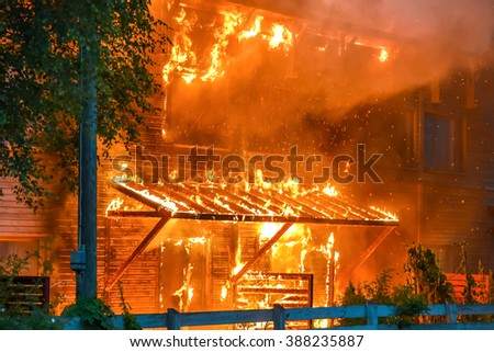 House is on fire - stock photo