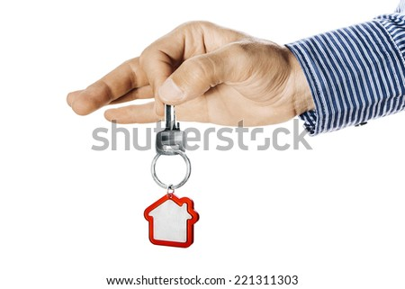 House key in hand isolated on white - stock photo