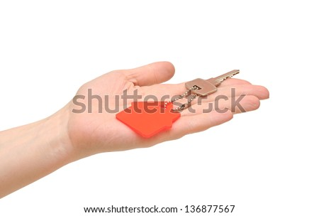House key in hand on white - stock photo