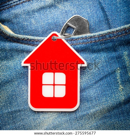 House key in jeans pocket, close-up - stock photo