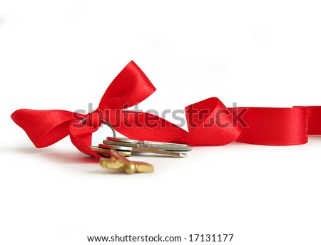 House keys decorated by red ribbon - stock photo