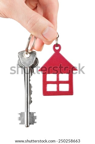 House keys in hand isolated on white background - stock photo