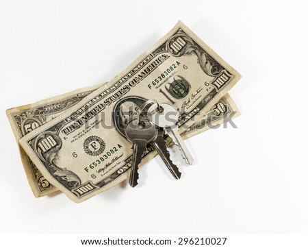 House keys with US hundred dollar bill on a white background - stock photo