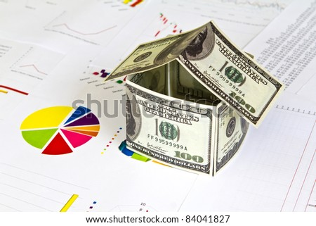 House made from dollars on financial Graphs - stock photo