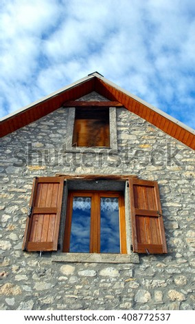 house made in stone with wood windows - stock photo
