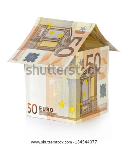 House made of money on a white background. - stock photo
