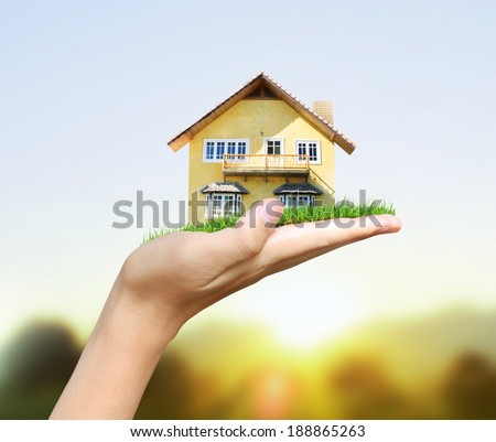 House model  concept in the hand - stock photo