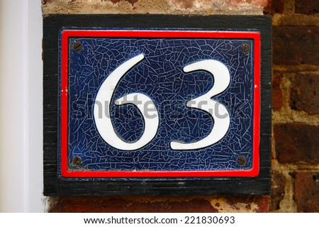 house number 63 - stock photo