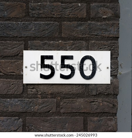house number five hundred and fifty. Black numerals on a white background - stock photo