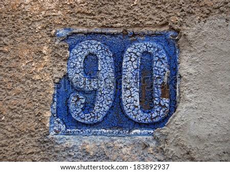 house number ninety - stock photo