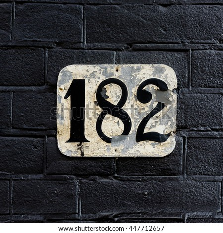 house number one hundred and eighty two - stock photo