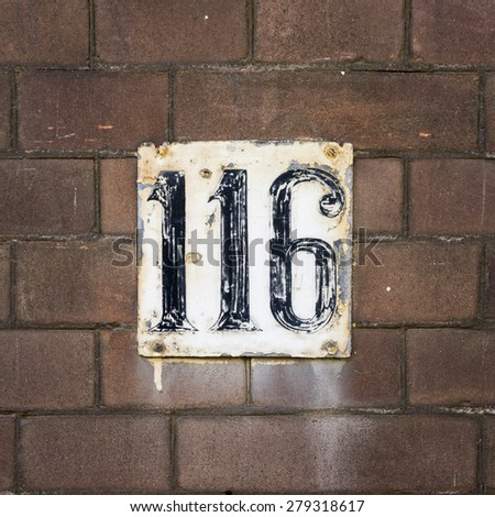 House number one hundred and sixteen - stock photo