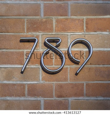 house number seven hundred and eighty nine made out of a stainless steel bar. - stock photo